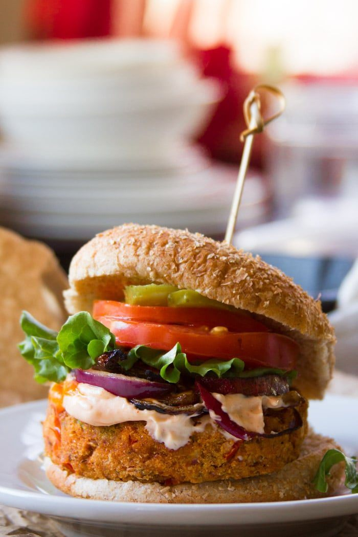 white plate with a colorful cajun black-eyed pea burger that can be enjoyed for some vegan soul food