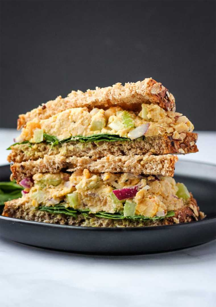 black table with two portable vegan tuna salad sandwiches as cold lunch ideas