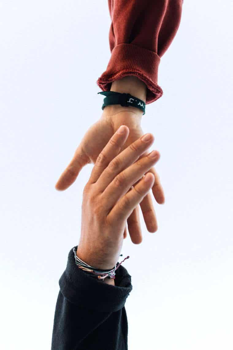 Close up of woman and man hand reaching at each other