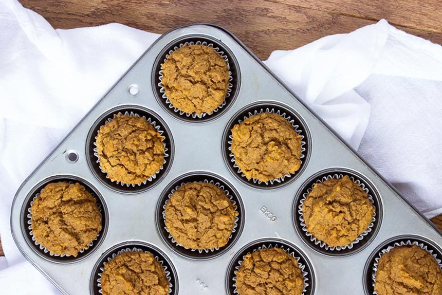 Vegan Pumpkin Muffins in baking dish from the top on a white linen