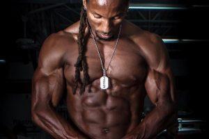 african american bodybuilder torre washington without his shirt showing his vegan muscle