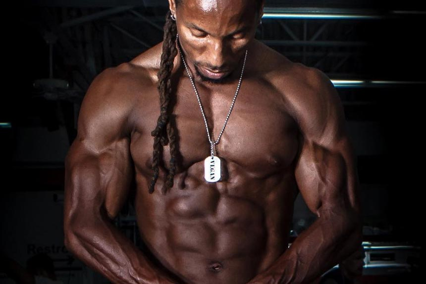 Torre Washington, vegan bodybuilder without his shirt showing his muscle