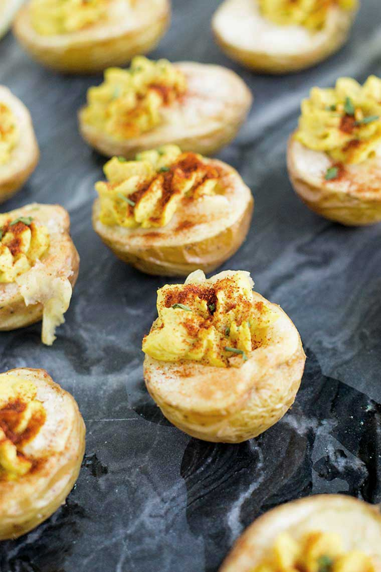 halved potatoes with vegan cream on top for a healthy Easter appetizer