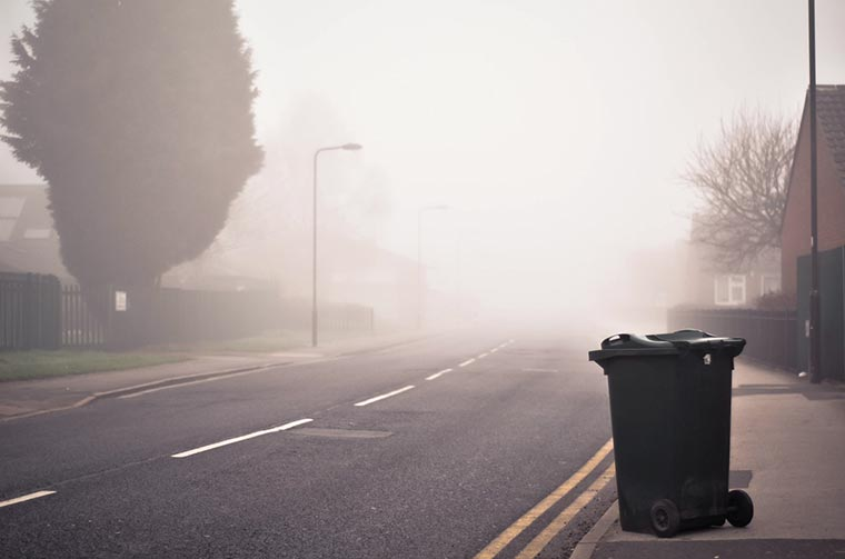 trash bin standing on street