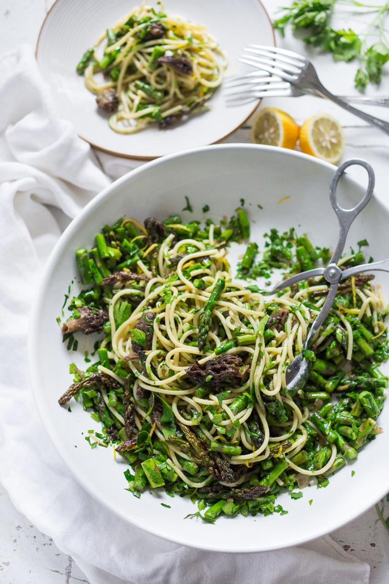 white bowl of a green vegan easter pasta salad on a table