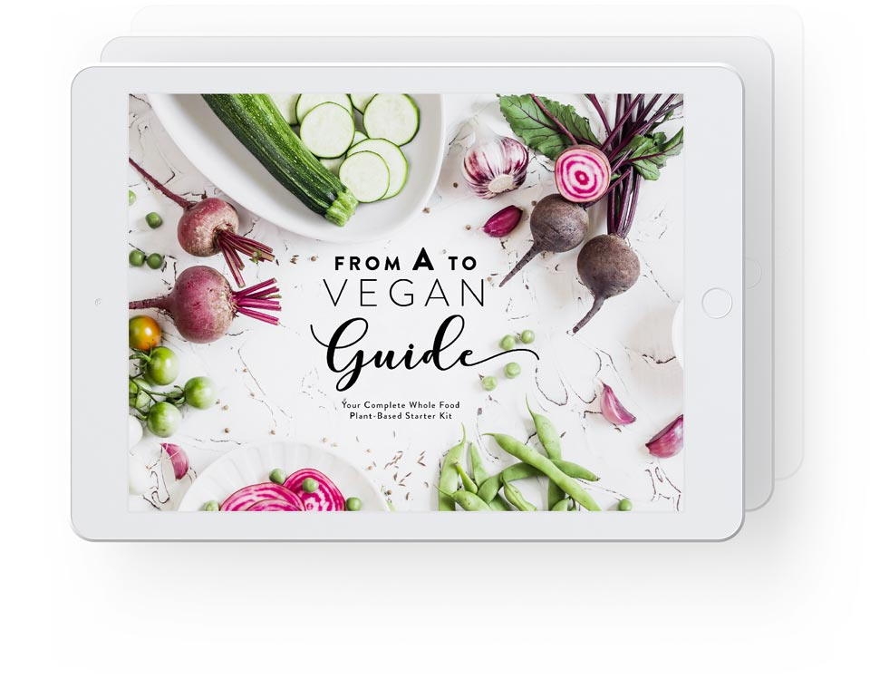 White iPads in horizontal position showcasing vegan starter kit with main guide in front and more ebooks indicated behind