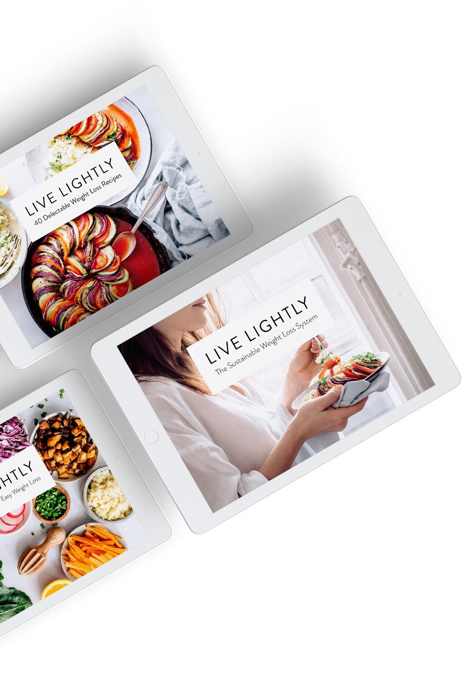 top view of three ipads showcasing the different ebooks of nutriciously's weight loss system