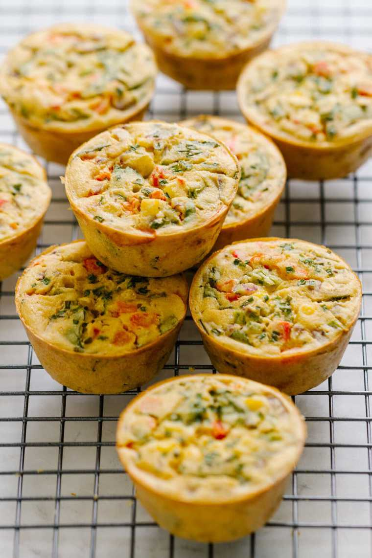 cooling rack with 9 homemade mini chickpea flour frittata muffins for a cold vegan lunch idea
