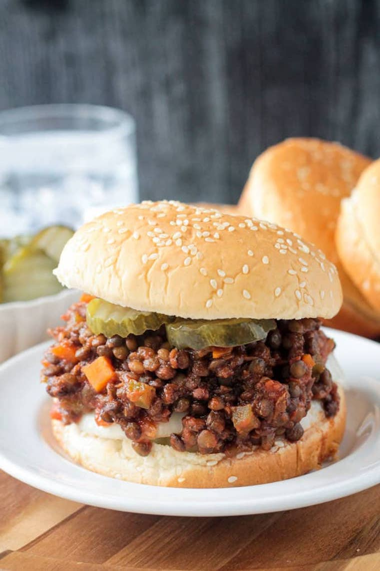 white plate with vegan lentil sloppy joes on a wooden table