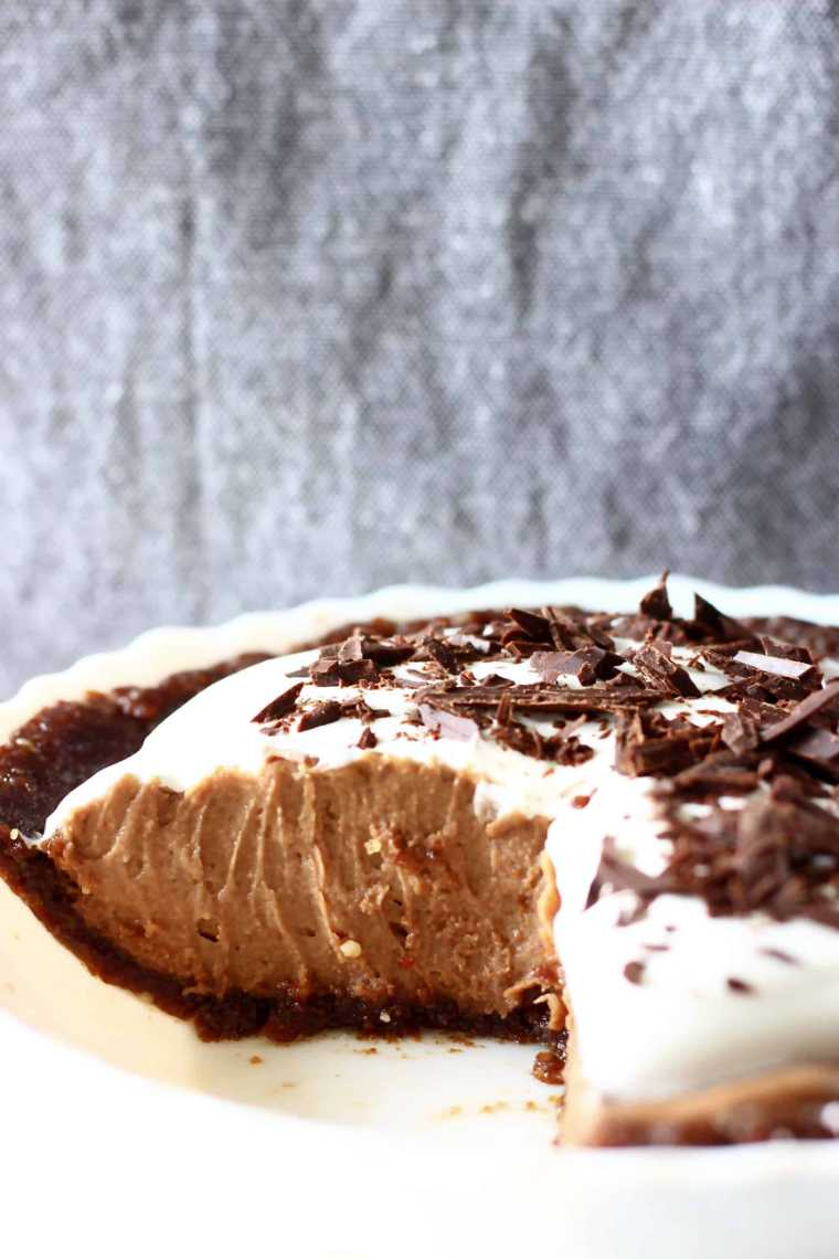 pie form with no-bake crust and creamy vegan chocolate filling