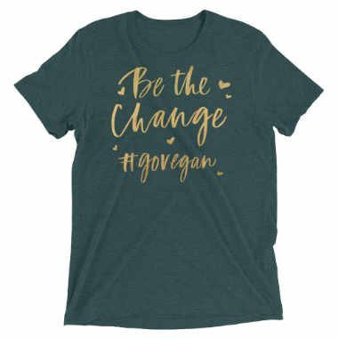 green tshirt saying be the change go vegan in yellow letters