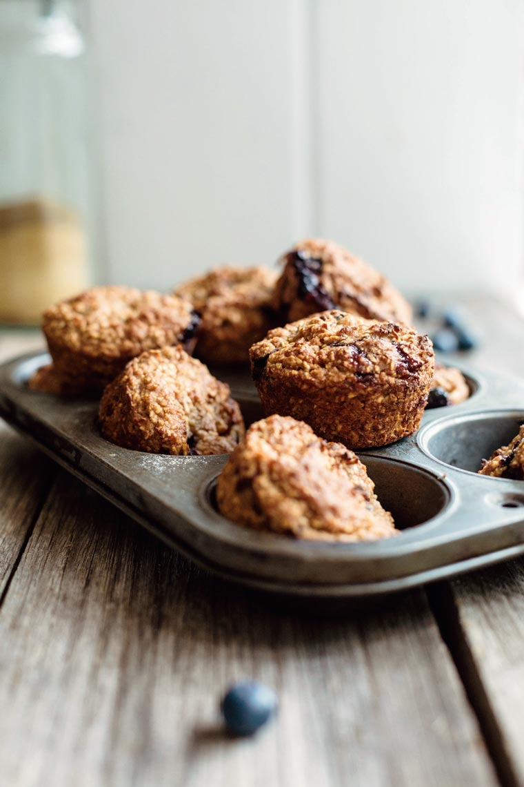 baking dish with freshly baked gluten-free blueberry muffins on a wooden table