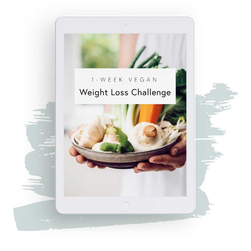 White iPad showcasing Nutriciously's 6-part vegan weight loss challenge with green brush in the background