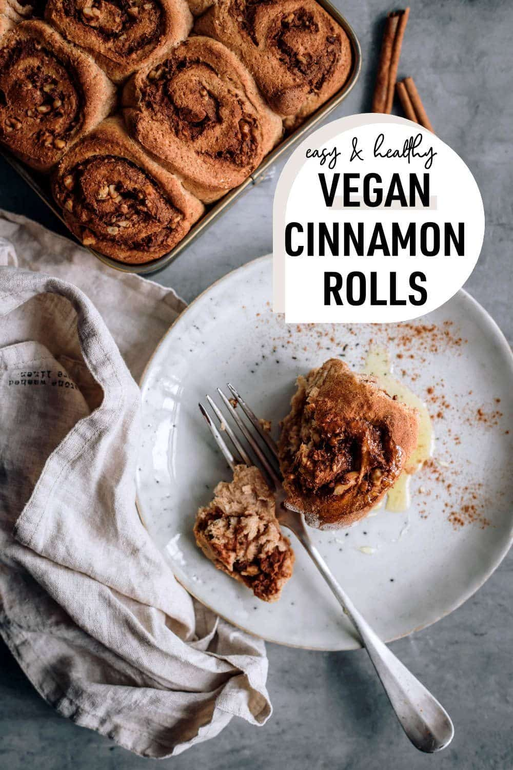 picture of vegan cinnamon rolls from the top with a drop shape saying vegan cinnamon rolls
