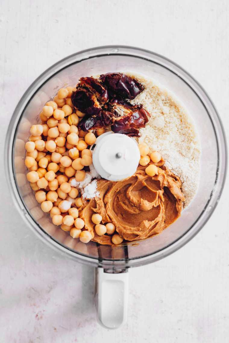 food processor with chickpeas, flour, dates and peanut butter