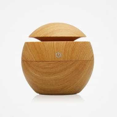 wooden essential oil diffuser lamp on white background