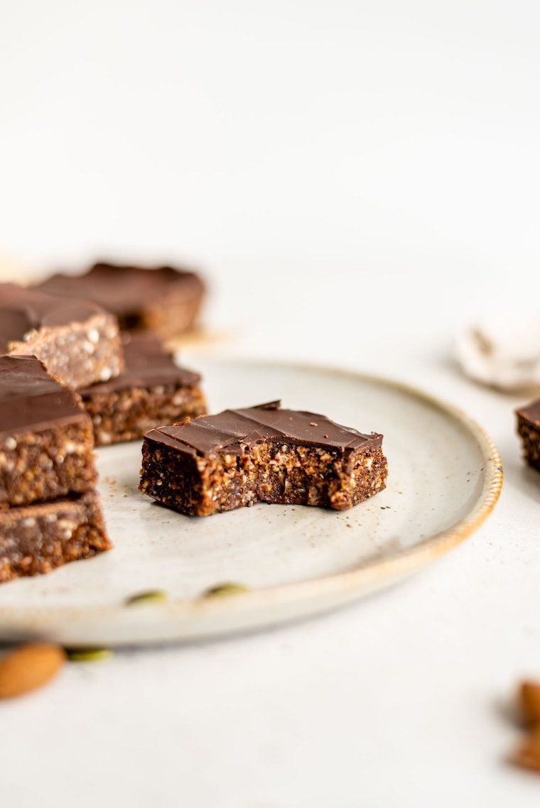 plate with several homemade no bake energy bars for a vegan high-protein post-workout snack