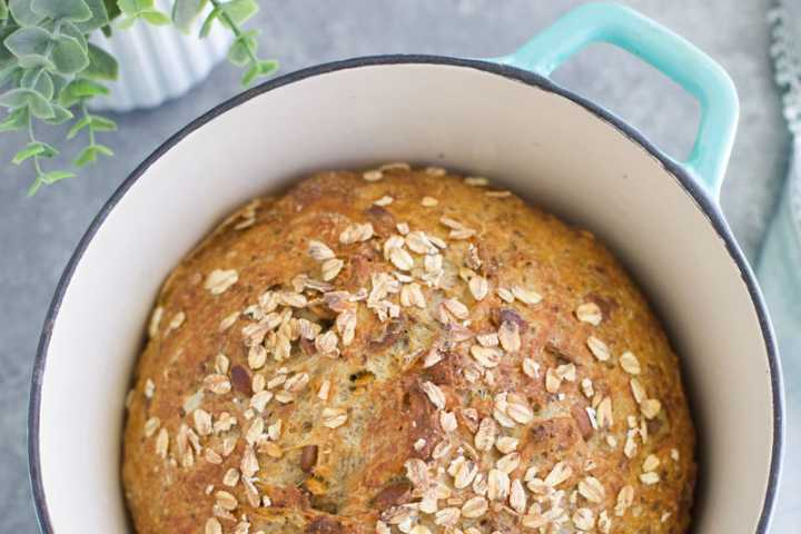 No-Knead Whole Wheat Bread in a Baking Dish on a Grey Table