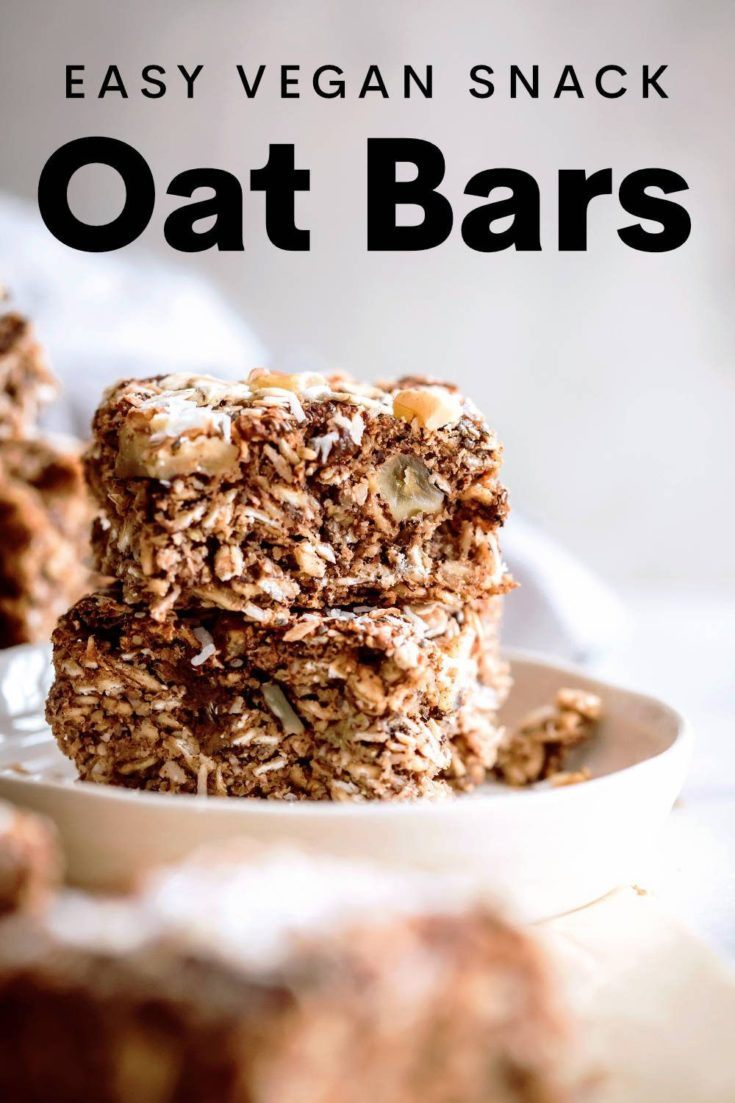 These easy Vegan Oat Bars are made with just a handful of simple and wholesome ingredients, naturally gluten-free - no oil, no refined sugar, just 100% satisfying deliciousness.  A delicious and easy snack, kid-friendly and totally suitable for breakfast. | nutriciously.com  #VeganOatBars #HealthyOatBar #GlutenFreeSnack