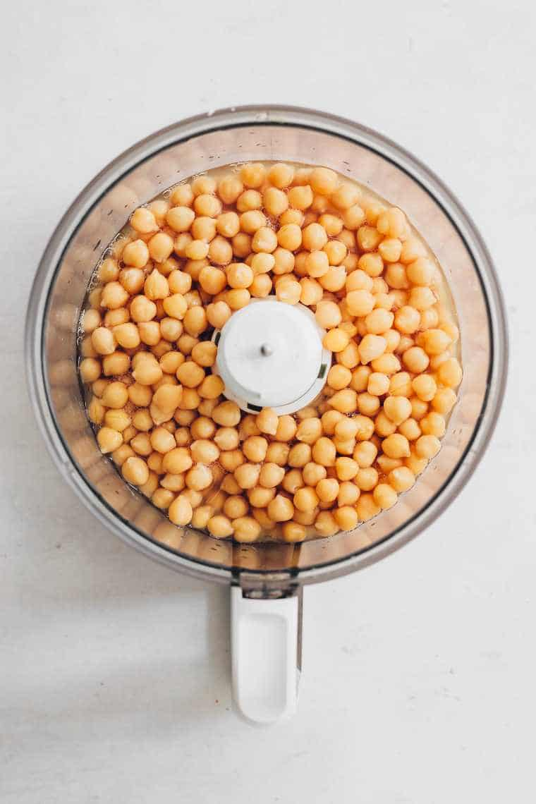 top view of food processor jar with chickpeas and liquid