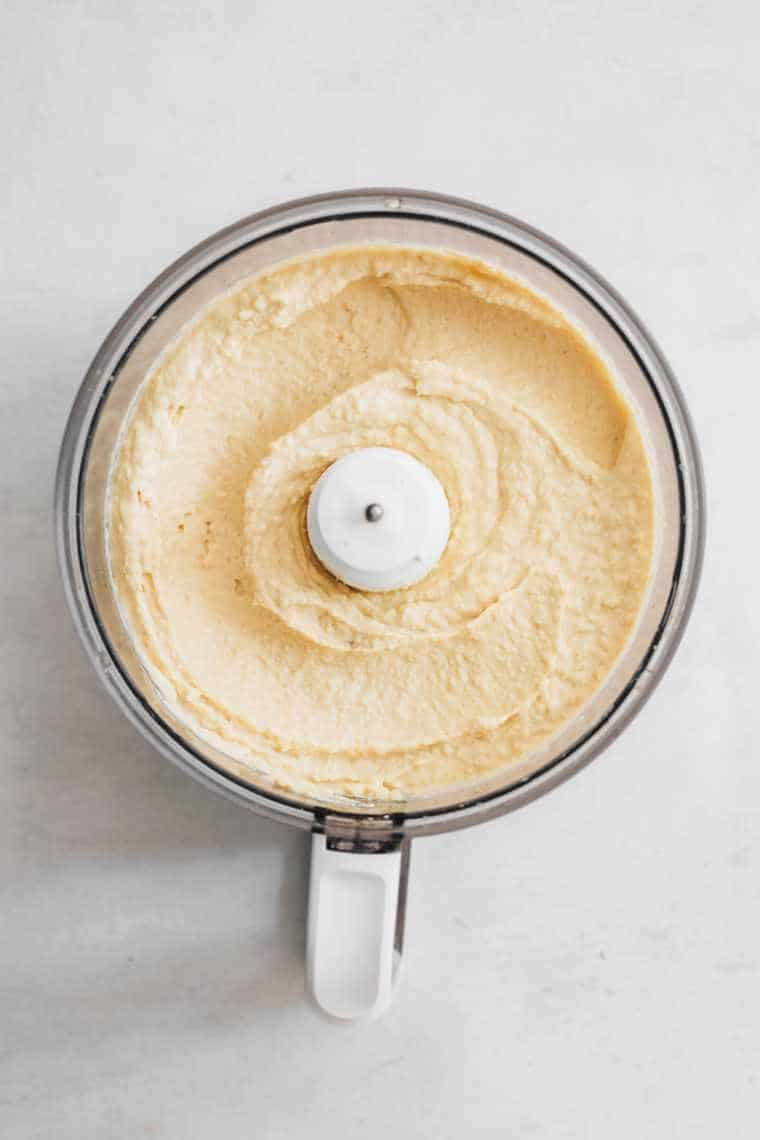 freshly blended chickpeas hummus in food processor