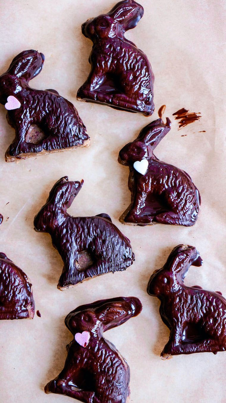 parchment paper with six bunny-shaped raw vegan chocolate treats