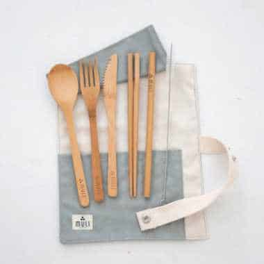 reusable bamboo spoon, fork, knife and straws on a cotton travel wrap