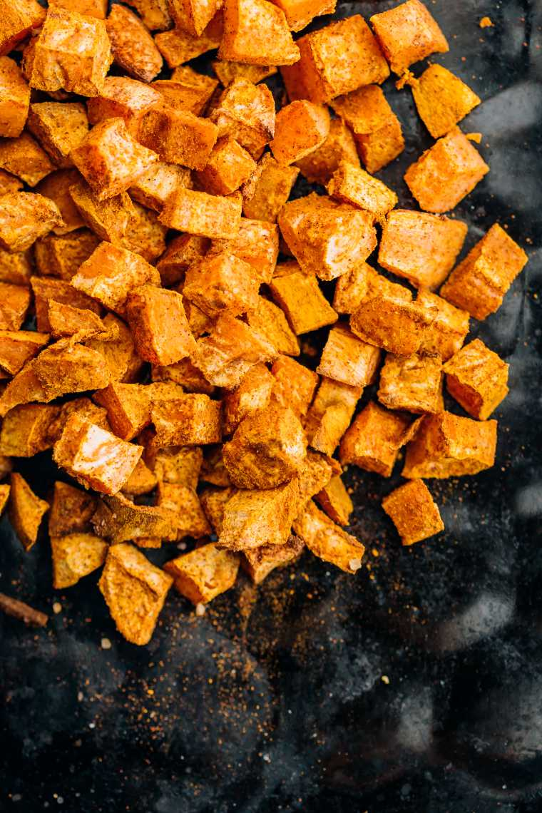 top view of golden roasted sweet potato cubes