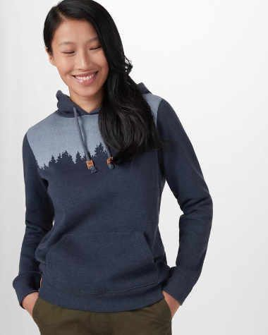 asian woman with long black hair smiling down and wearing a blue tentree hoodie as a vegan christmas gift