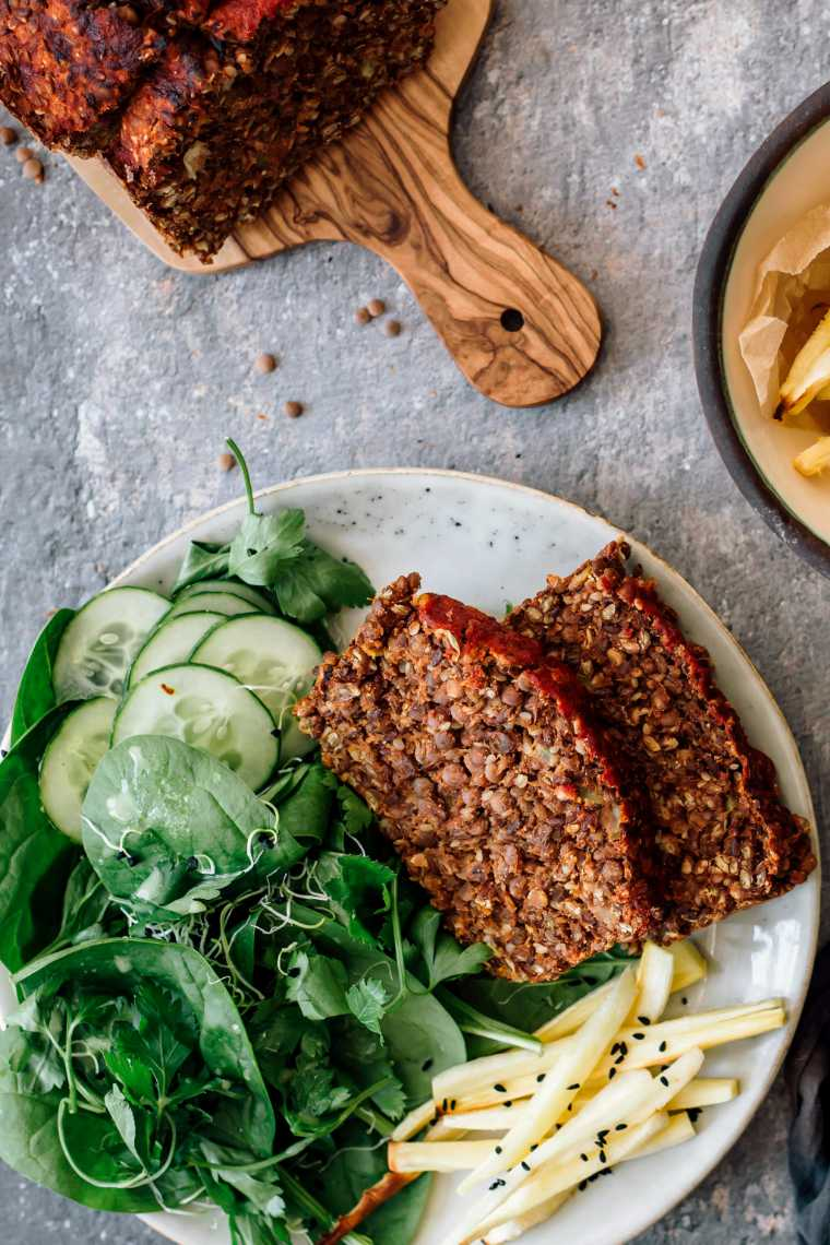 plate with green salad, parsnip fries and two slices of homemade vegan meatloaf