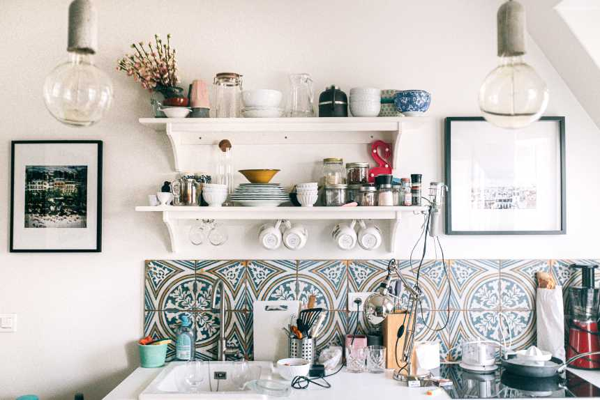 vintage kitchen with flowers, colorful tiles, sink and different kitchen tools