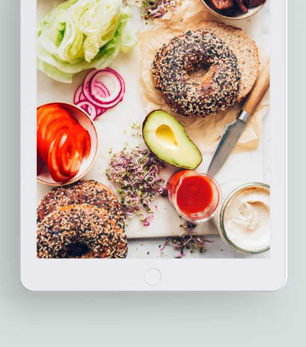 iPad with different plant-based foods on its screen representing Nutriciously's Vegan Starter Kit