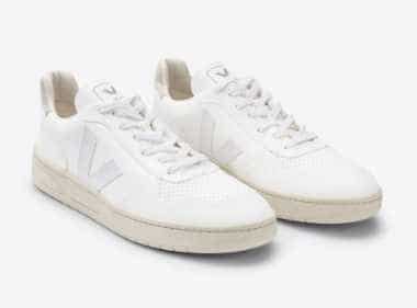 pair of vintage white vegan trainers from Vega on a white surface