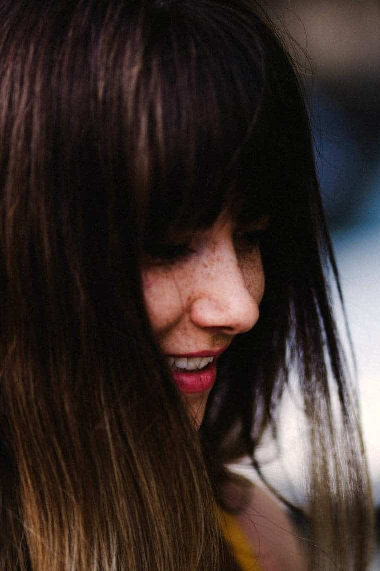 Closeup of smiling woman with brown hair