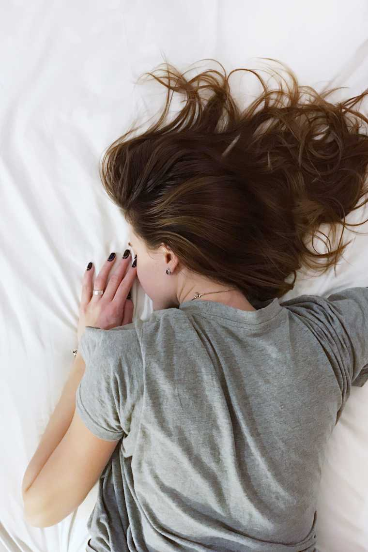 Brown Haired Woman Lying Face Down on Bed and Sleeping