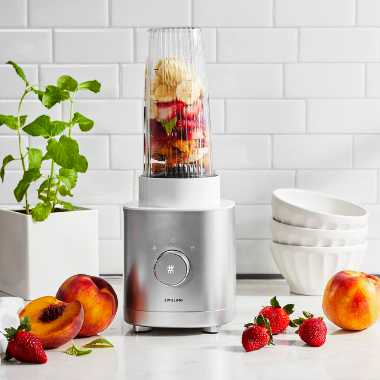kitchen countertop with fresh fruit next to a silver personal blender by the brand Zwilling