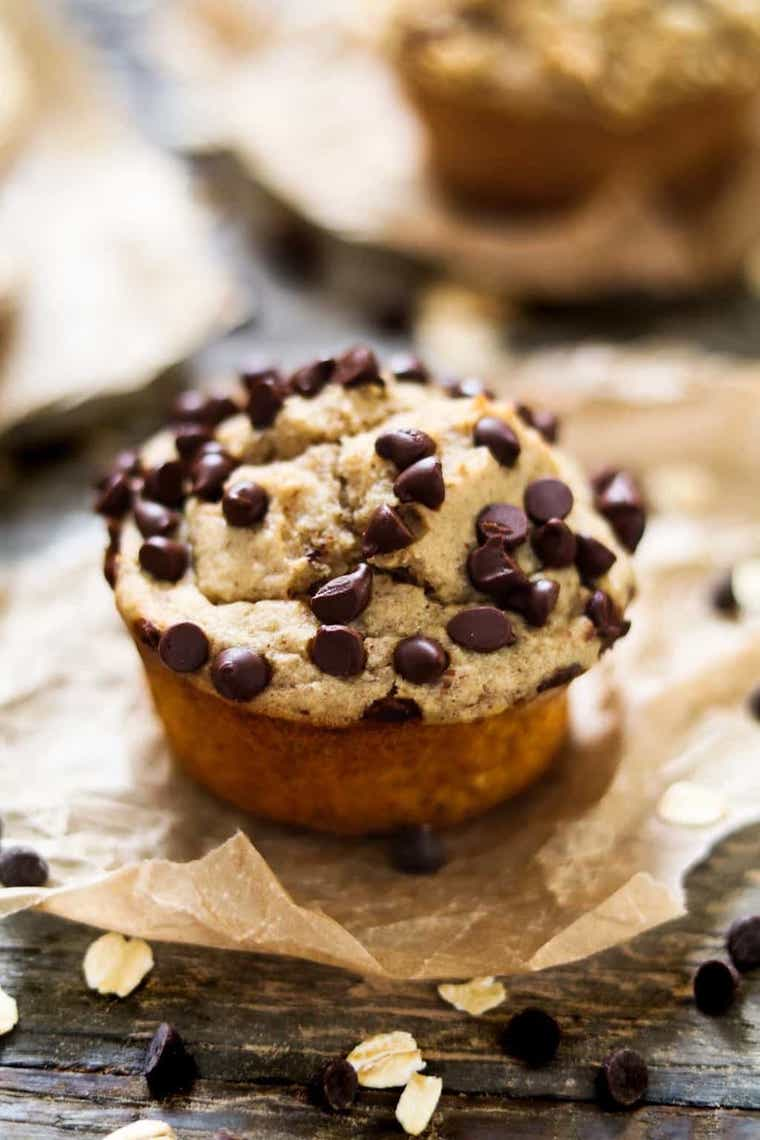 close up of one vegan protein muffin topped with chocolate chips which can be eaten as a post-workout snack