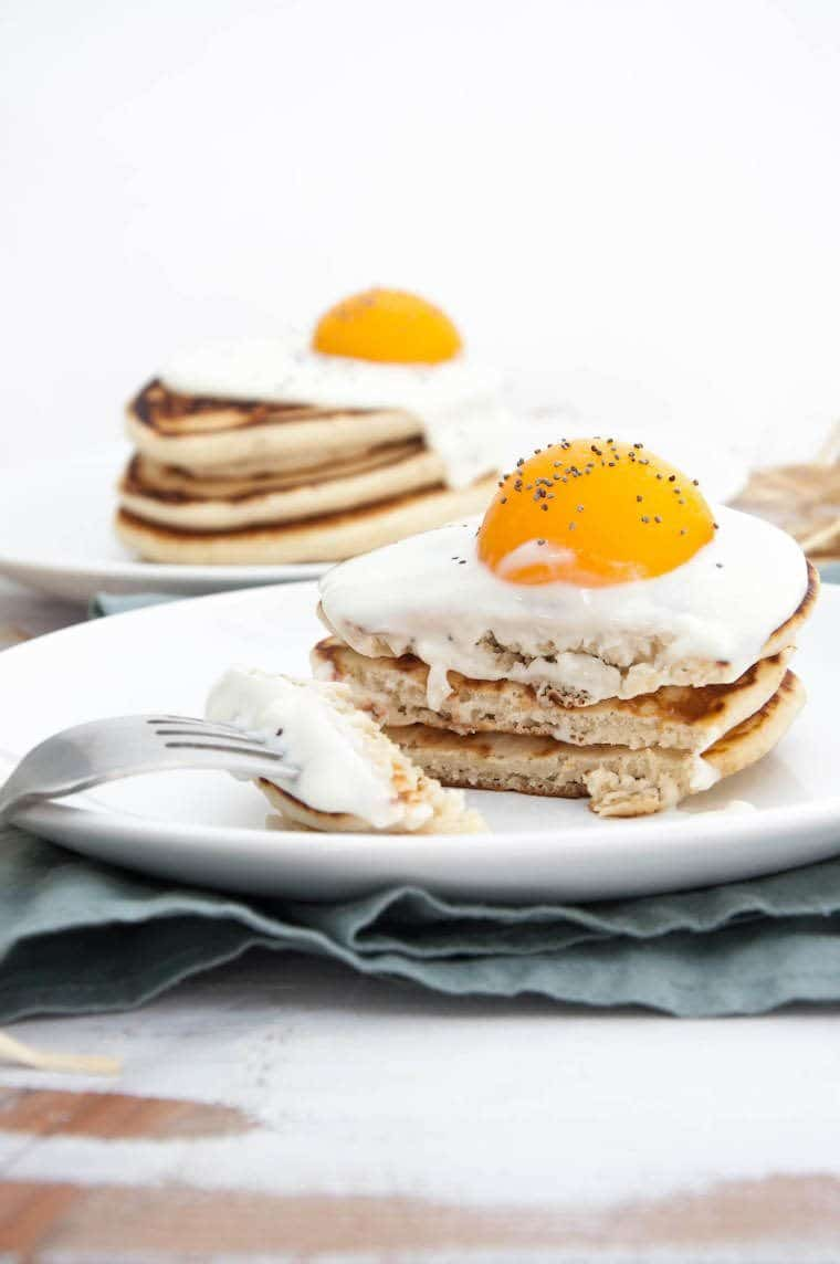stack of three vegan pancakes with yogurt and an apricot as a vegan Easter recipe idea